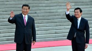Tập Cận Bình gặp Trương Tấn Sang tại Bắc Kinh. Ảnh: AFP